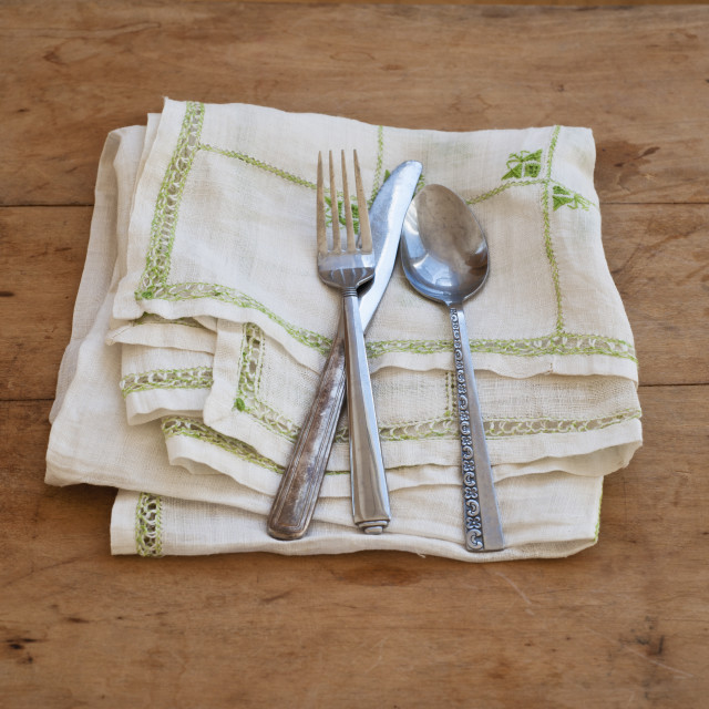 """Close up of silverware on dish towel"" stock image"