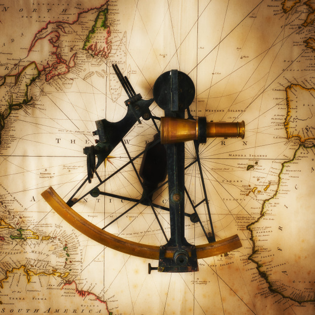 """Sextant on old map, directly above"" stock image"