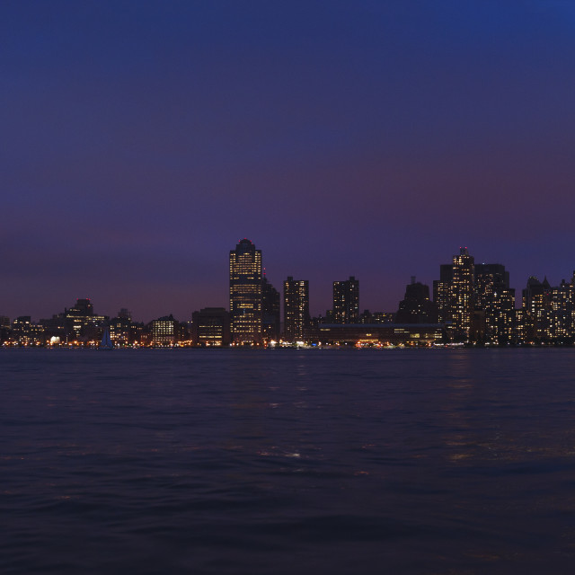 """""""Panorama of New York at night with tribute in light"""" stock image"""