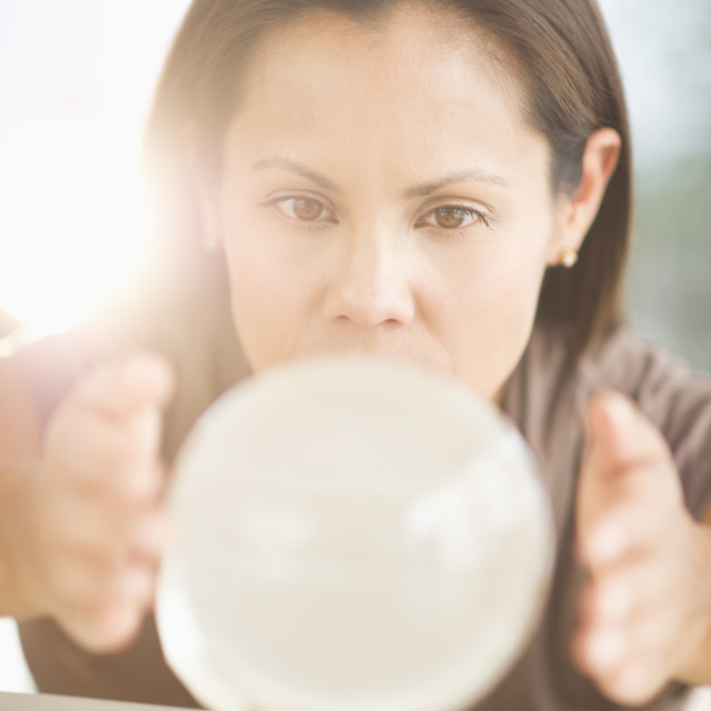 """""""Woman looking into crystal ball"""" stock image"""