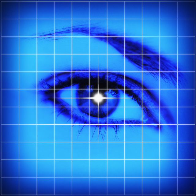 """Studio shot of grid pattern with female eye"" stock image"