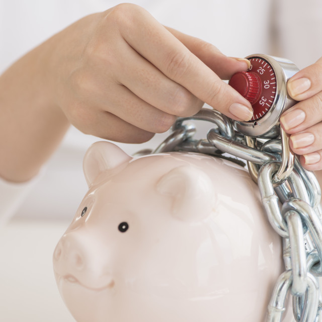 """""""Piggybank closed with chain and combination lock"""" stock image"""