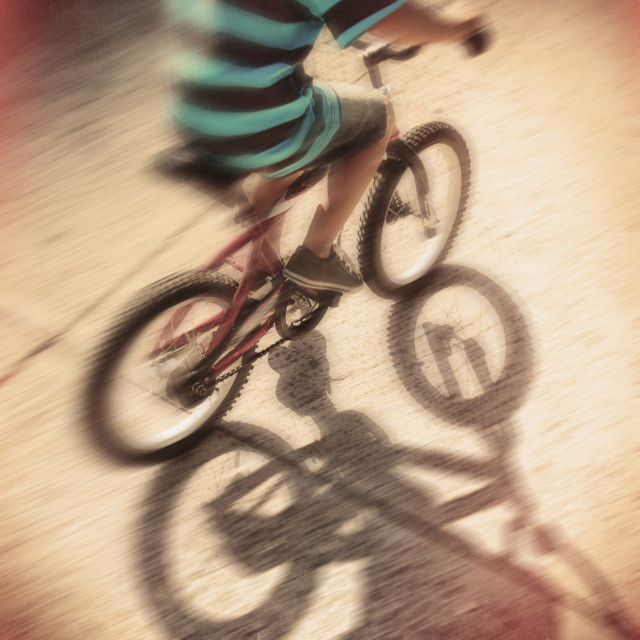 """""""Low section of boy (6-7) riding bicycle"""" stock image"""