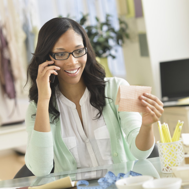 """""""Female entrepreneur in workplace"""" stock image"""