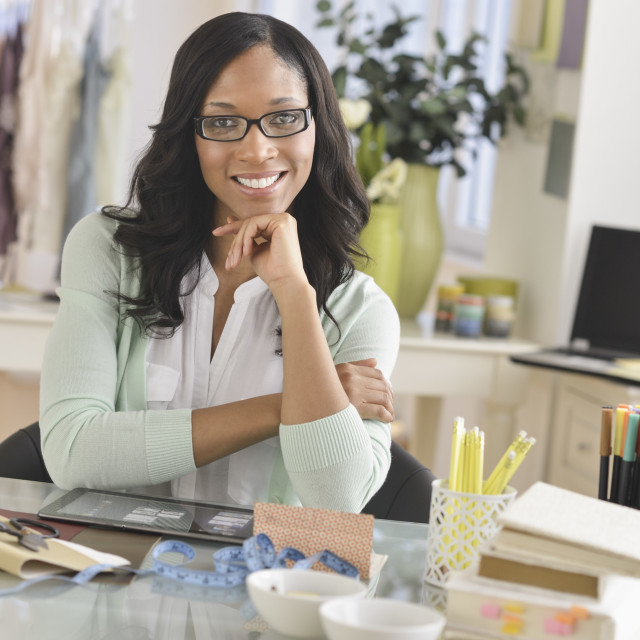 """""""Portrait of female entrepreneur in workplace"""" stock image"""