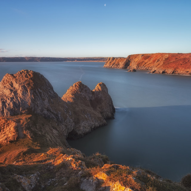 """""""Rugged Three Cliffs Bay and the Great Tor"""" stock image"""