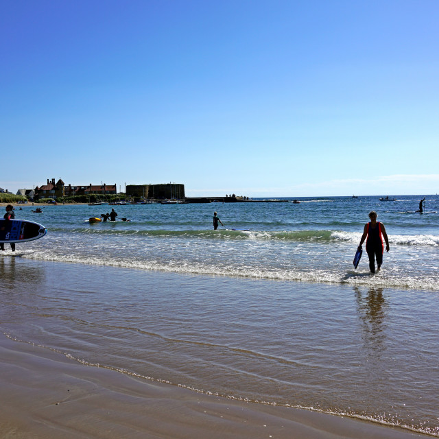 """""""Swimmers at Beadnell, Northumberland"""" stock image"""