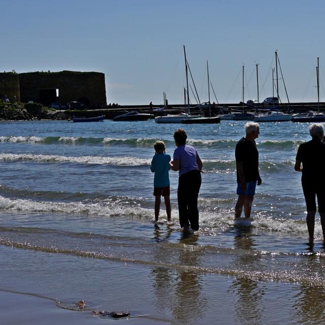 """Swimmers, Beadnell, Northumberland"" stock image"