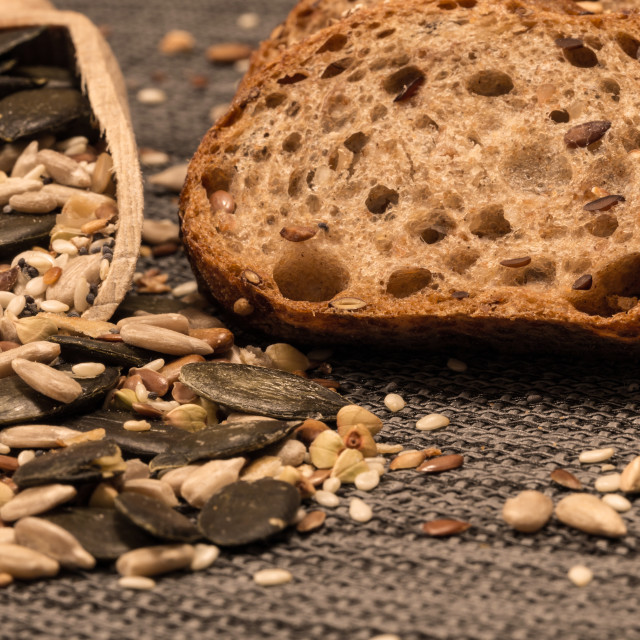 """Bread background closeup with cereals mix 7"" stock image"