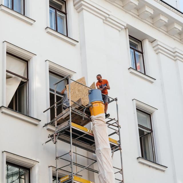"""""""Construction worker on scaffold in building"""" stock image"""
