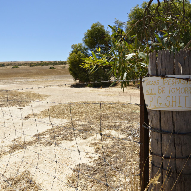 """Rural trespassing sign"" stock image"