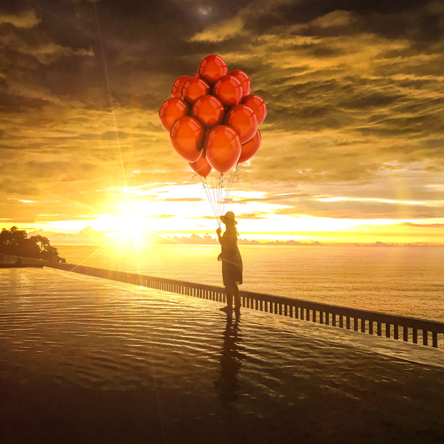 """""""A Girl, Balloons and a sunset"""" stock image"""