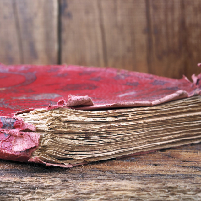 """""""close up on old book with red cover"""" stock image"""