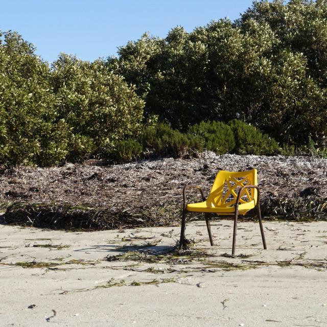 """Yellow chair on beach"" stock image"
