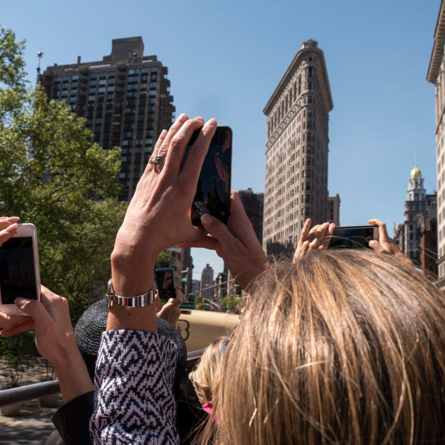 """Tourists photographing Flatiron Building, New York"" stock image"