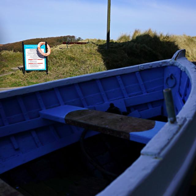"""Boat and Lifebelt, Beadnell, Northumberland"" stock image"