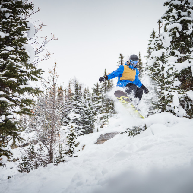 """Girl snowboarding jump"" stock image"