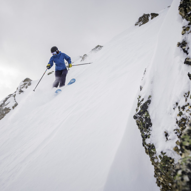 """Female skier in steep terrain"" stock image"