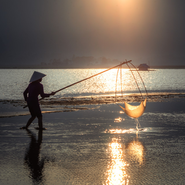 """Livelihood 3 - Sunset at Bavi Lake"" stock image"