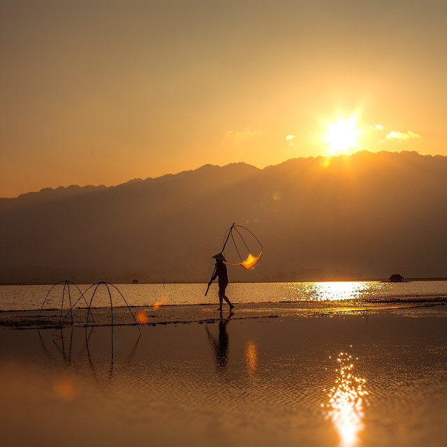 """Livelihood 4 - Sunset at Bavi Lake"" stock image"