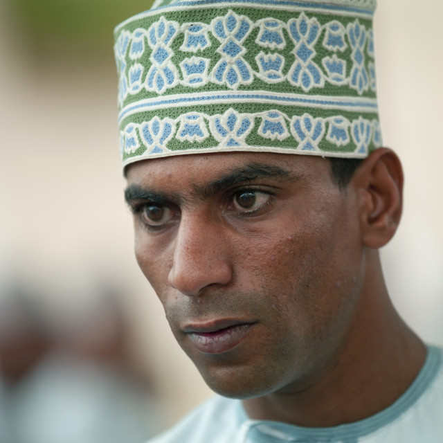 """A Man Wearing A Green Cap, Nizwa, Oman"" stock image"