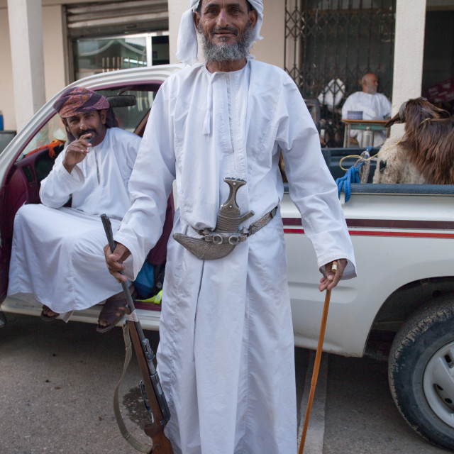 """""""Old Man Wearing A Khanjar And Holding A Gun In The Right Hand While A Stick..."""" stock image"""