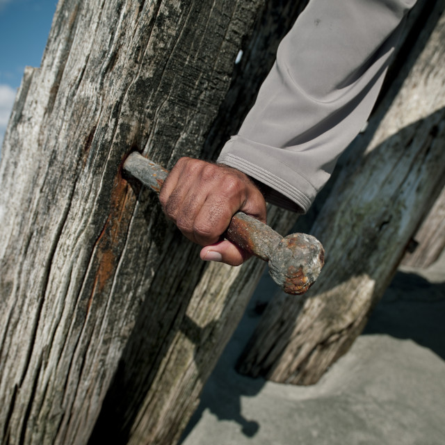 """A Hand Holing A Big Nail In Dhow, Masirah Island , Oman"" stock image"