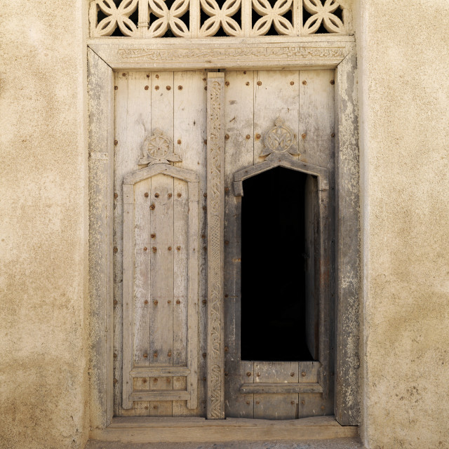 """""""Wooden Door Carved In Arabic Style Of Old Dhofari House In Taqa, Oman"""" stock image"""