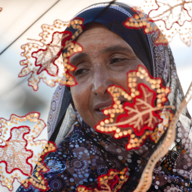 """Old Woman Behind The Flower Gauze, Sinaw, Oman"" stock image"