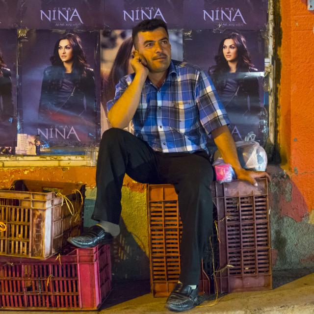 """Man Sitting In The Street, Suleymanyah, Kurdistan, Iraq"" stock image"