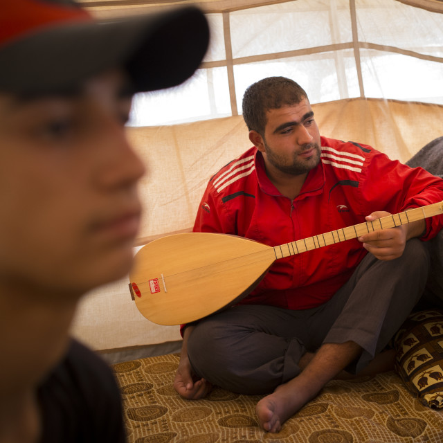 """Syrian Refugee Playing Saz, Erbil, Kurdistan, Iraq"" stock image"