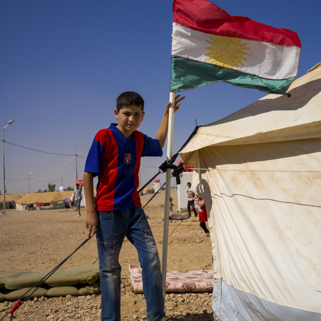 """Syrian Refugee Child With A Barcelona Shirt In Front Of His Tent, Erbil,..."" stock image"