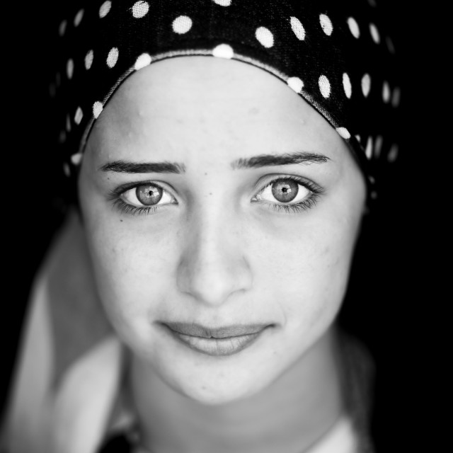 """Close-up Of A Young Syrian Refugee Face With Blue Eyes, Erbil, Kurdistan, Iraq"" stock image"