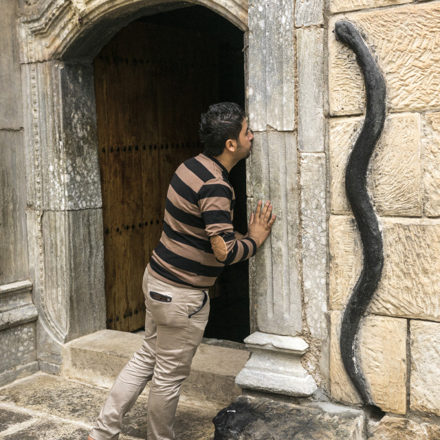 """""""A Man Kisses A Door In The Historic Temple Of Yazidis In The Village Of..."""" stock image"""
