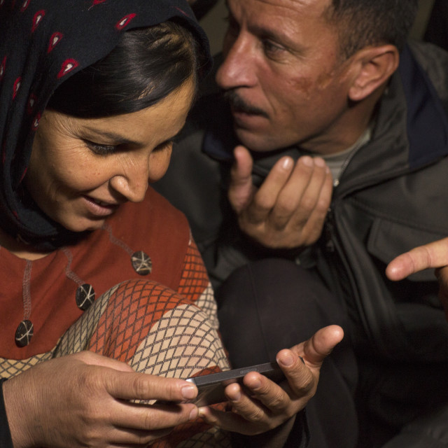 """""""Yezedi Refugees From Sinjar Making A Conference On A Mobile Phone With..."""" stock image"""