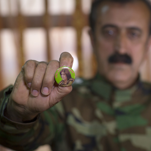 """Yousuf Majid With A Badge Of His Dead Daughter Captain Rangin Yousuf Killed..."" stock image"