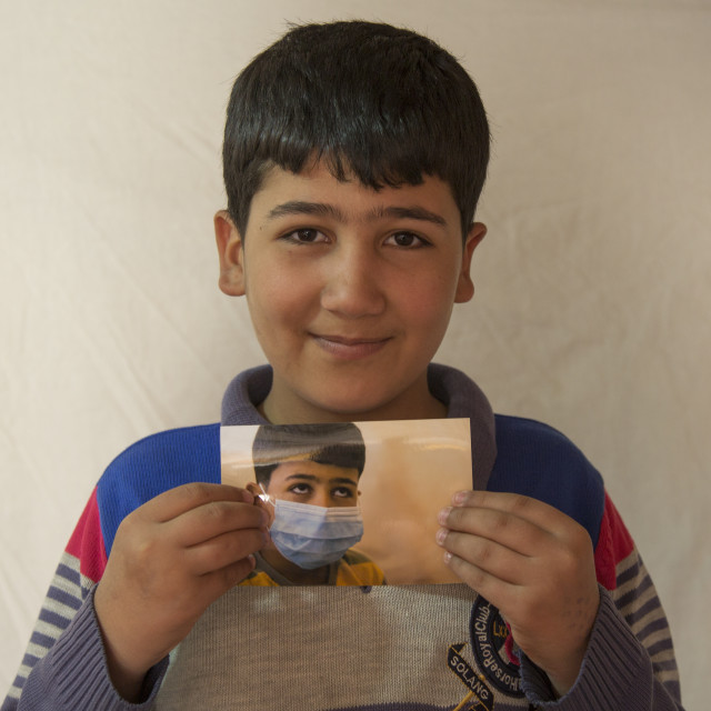 """Elias, A Syrian Refugee In Qushtapa Refugee Camp Holding A Picture Of..."" stock image"