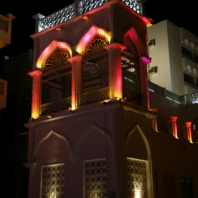 """""""Building Under Colourful Light During The Night, Muttrah Corniche, Oman"""" stock image"""