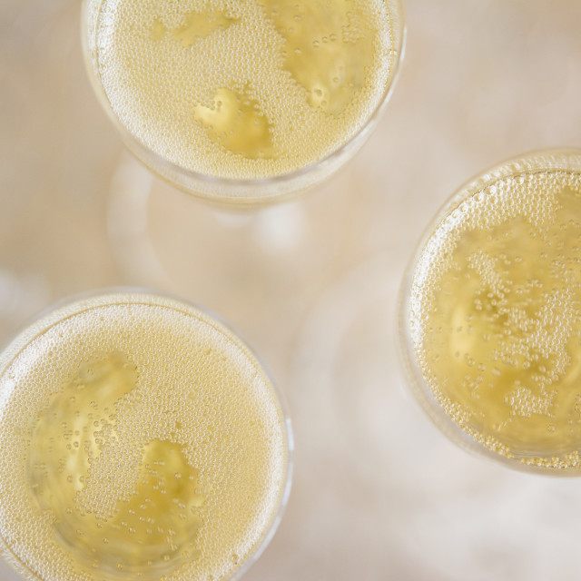"""Directly above view of champagne flutes"" stock image"