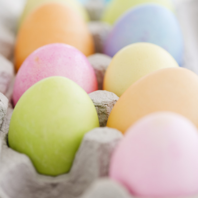 """Dyed Easter eggs in carton"" stock image"