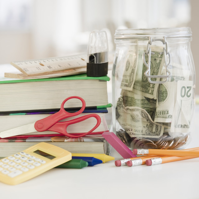 """Stationery and jar of money"" stock image"