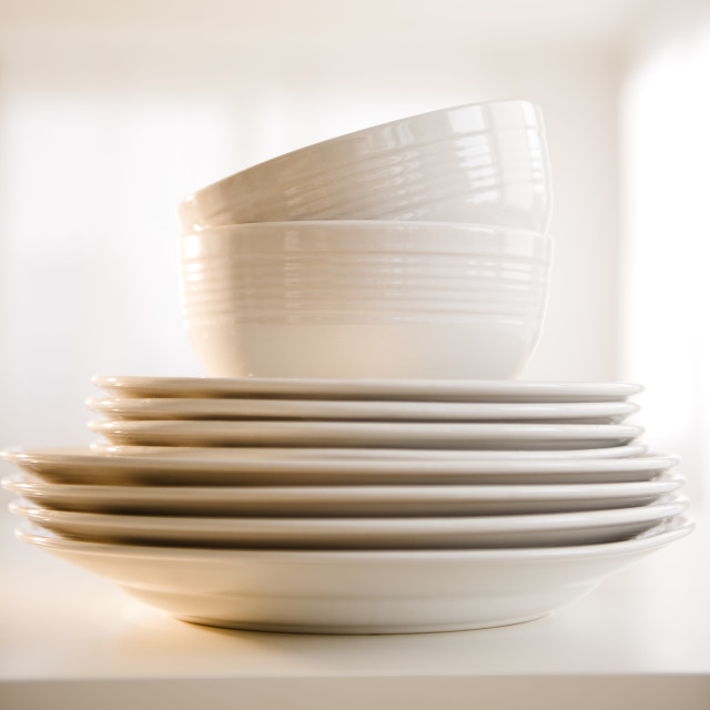 """""""Close up of stack of dinnerware"""" stock image"""