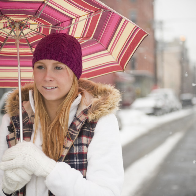 """""""USA, New Jersey, Jersey City, woman with umbrella on street"""" stock image"""