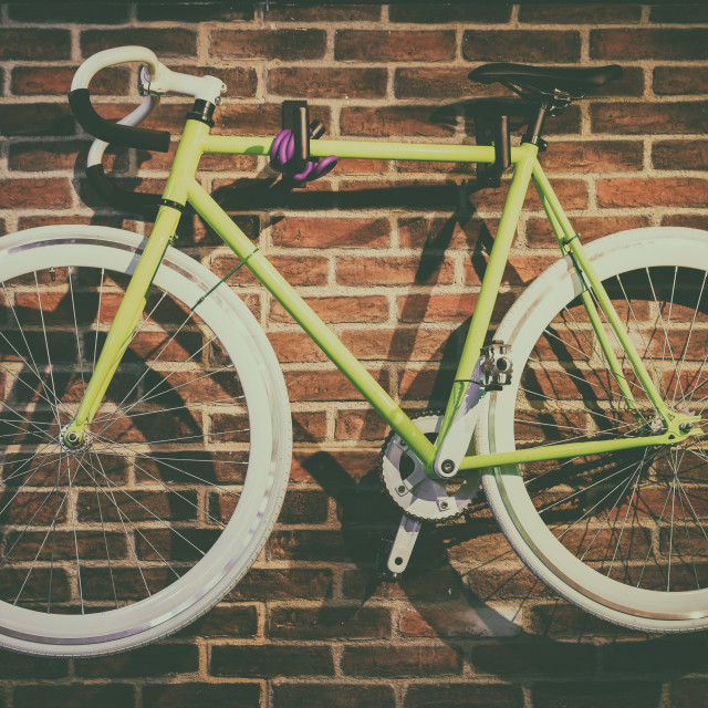 """Bike Hanged On Brick Wall"" stock image"