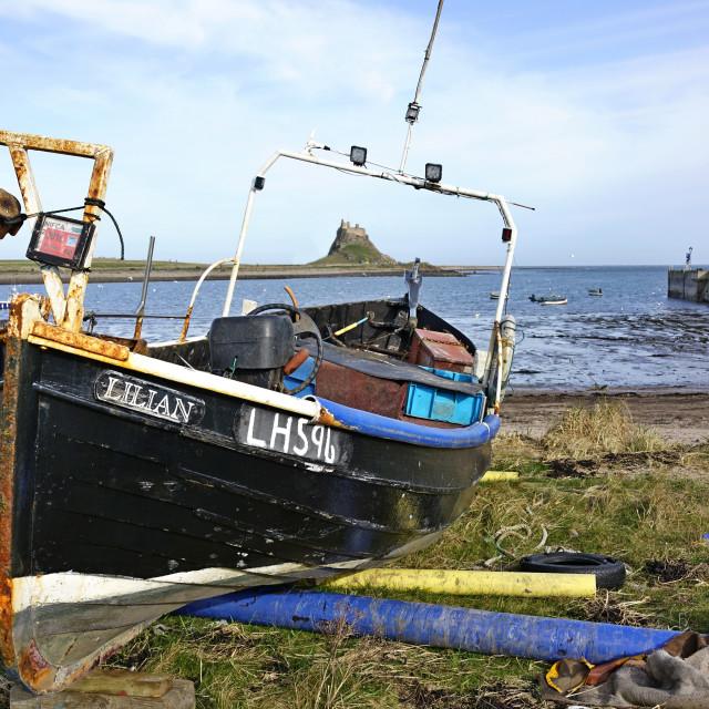 """Boat and Castle, Lindisfarne, Northumberland"" stock image"