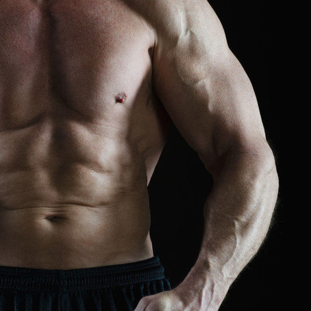 """""""Muscular man flexing his muscles"""" stock image"""
