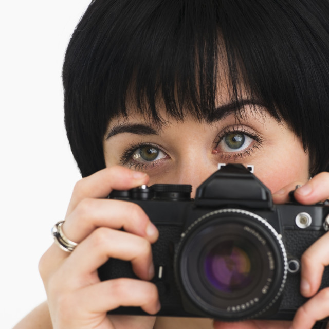 """Woman holding a camera"" stock image"