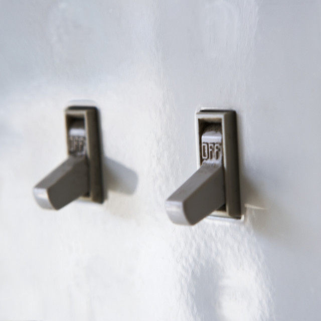 """""""Close up of light switches"""" stock image"""