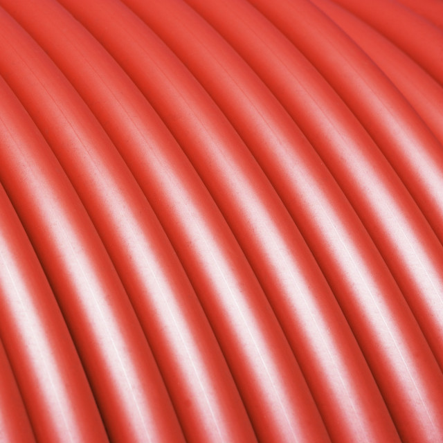 """Close up of rolled hose"" stock image"