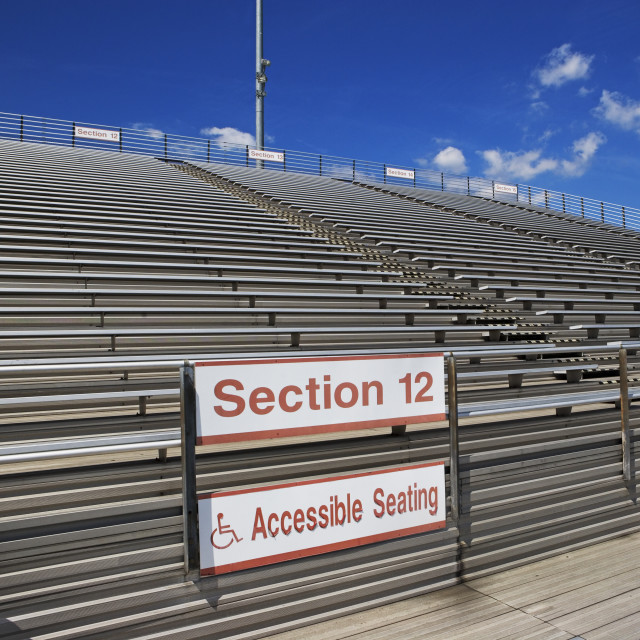 """Stadium bleachers with wheelchair accessible seating"" stock image"